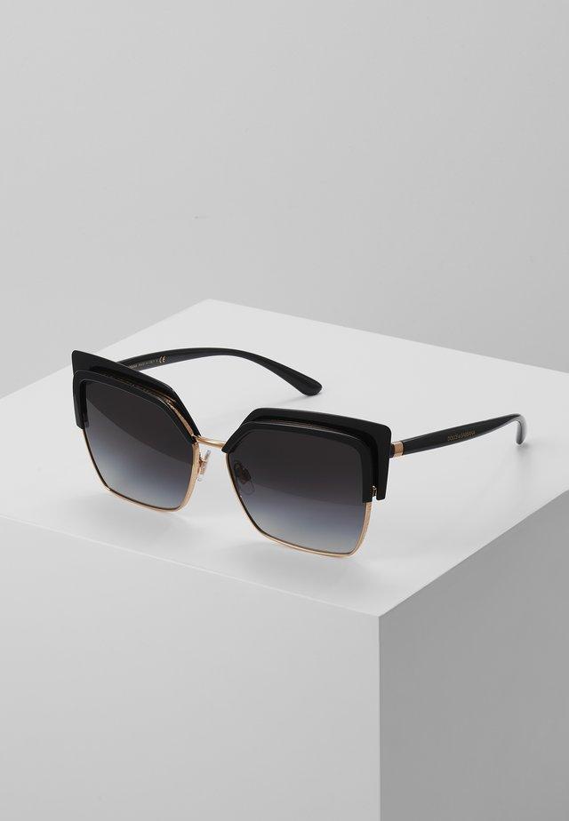 Aurinkolasit - black/gold-coloured