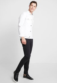 DOCKERS - SMART 360 FLEX ALPHA SKINNY - Chino kalhoty - black - 1