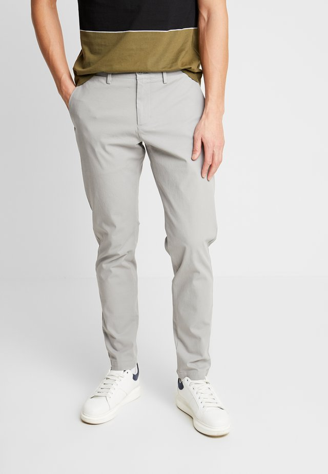 SMART FLEX TAPERED - Trousers - wet stone