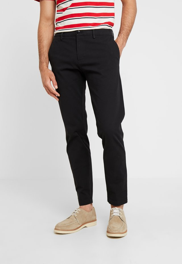SMART FLEX TAPERED - Trousers - black