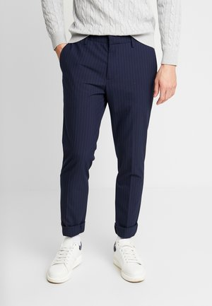 SMART FLEX TROUSER - Chinos - curry pembroke