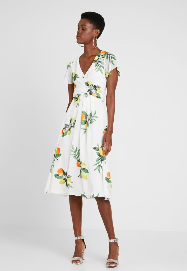 BILLIE LEMON PRINT WRAP MIDI - Day dress - ivory
