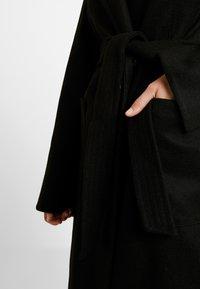 Dorothy Perkins Tall - PATCH WRAP - Kåpe / frakk - black - 6
