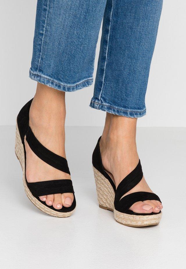 RAVELLO ASYMETTRIC WEDGE - High heeled sandals - black