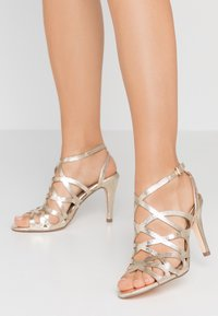 Dorothy Perkins - SPIKE CAGE - High heeled sandals - champagne - 0