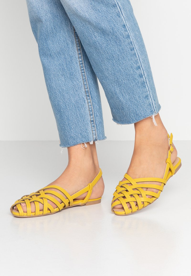 Dorothy Perkins - PIONEER HUARACHE SLING BACK - Sandals - yellow