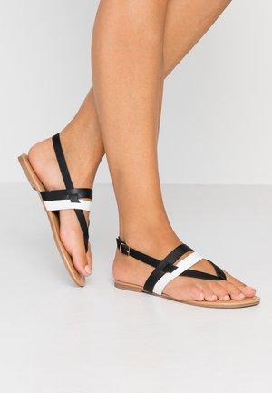 FUTURE - T-bar sandals - black/white