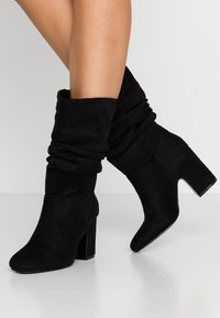 Dorothy Perkins - KIND RUCHED 3/4 BOOT - Boots - black - 0