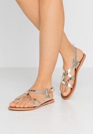 JAMIE GLADIATOR - Flip Flops - gold