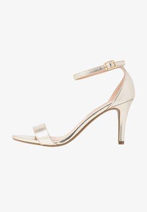 SIZZLE - Sandaler med høye hæler - gold