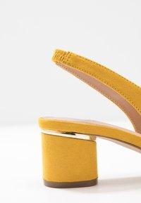 Dorothy Perkins - DOLLARCYCLINDER HEEL SLINGBACK COURT - Classic heels - yellow - 2