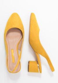Dorothy Perkins - DOLLARCYCLINDER HEEL SLINGBACK COURT - Classic heels - yellow - 3