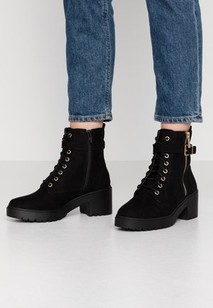 MANTA SIDE ZIP LACE UP - Platform ankle boots - black