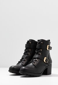 Dorothy Perkins - MARIE LACE UP HEELED BOOT - Lace-up ankle boots - black - 4