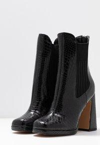 Dorothy Perkins - LOLA SKYE LOOPER ASYMETRIC SQUARE TOE BOOT - High heeled ankle boots - black - 4