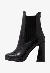 Dorothy Perkins - LOLA SKYE LOOPER ASYMETRIC SQUARE TOE BOOT - High heeled ankle boots - black - 1