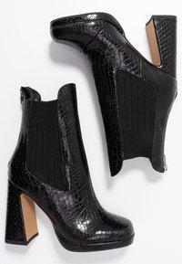 Dorothy Perkins - LOLA SKYE LOOPER ASYMETRIC SQUARE TOE BOOT - High heeled ankle boots - black - 3