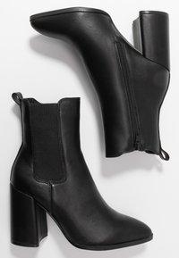 Dorothy Perkins - ARGYLE CHELSEA HEELED BOOT - Ankelboots med høye hæler - black - 3