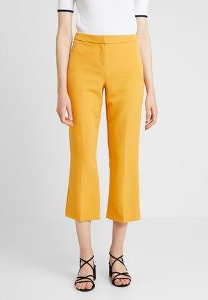 CROP KICK FLARE - Trousers - ochre
