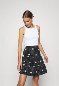Dorothy Perkins - DAISY SPOT TIERED MINI SKIRT - A-line skirt - black - 3