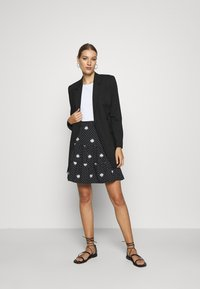 Dorothy Perkins - DAISY SPOT TIERED MINI SKIRT - A-line skirt - black