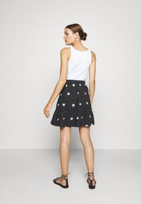 Dorothy Perkins - DAISY SPOT TIERED MINI SKIRT - A-line skirt - black - 2