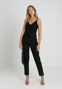 Dorothy Perkins - GLITTER  STRAPPY - Jumpsuit - black - 1
