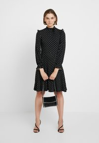 Dorothy Perkins - MULTI SPOT RUFFLE HIGH NECK SWING - Trikoomekko - black - 1
