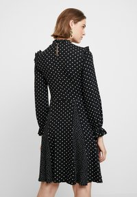 Dorothy Perkins - MULTI SPOT RUFFLE HIGH NECK SWING - Trikoomekko - black - 2