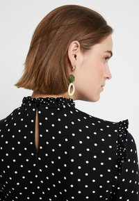 Dorothy Perkins - MULTI SPOT RUFFLE HIGH NECK SWING - Trikoomekko - black