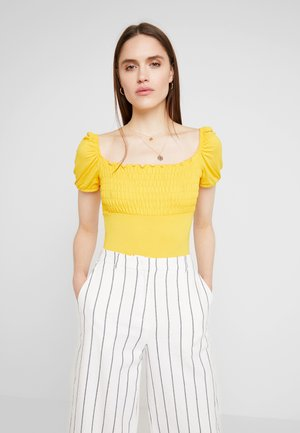 SHIRRED SHORT SLEEVE BODYSUIT - Linne - ochre