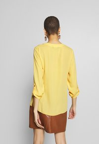 Dorothy Perkins - DOUBLE BUTTON COLLARLESS ROLL SLEEVE - Bluser - yellow - 2