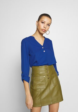 DOUBLE BUTTON COLLARLESS ROLL SLEEVE - Bluse - cobalt
