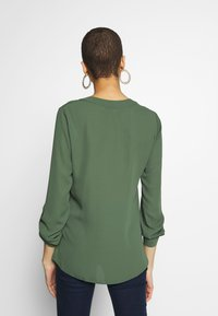 Dorothy Perkins - DOUBLE BUTTON COLLARLESS ROLL SLEEVE - Blouse - khaki - 2