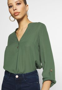 Dorothy Perkins - DOUBLE BUTTON COLLARLESS ROLL SLEEVE - Blouse - khaki - 5