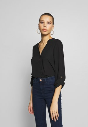 DOUBLE BUTTON COLLARLESS ROLL SLEEVE - Bluser - black