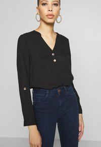 Dorothy Perkins - DOUBLE BUTTON COLLARLESS ROLL SLEEVE - Blouse - black - 3