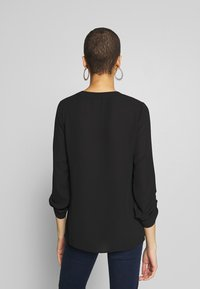 Dorothy Perkins - DOUBLE BUTTON COLLARLESS ROLL SLEEVE - Blouse - black - 2