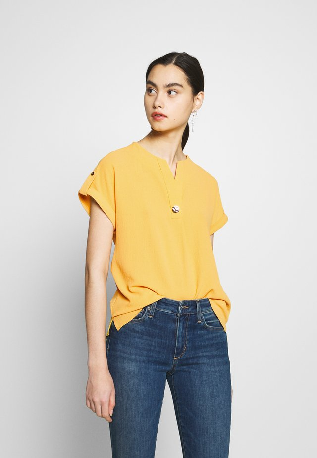 SUSTAINABLE DROP SHOULDER BLOUSE - Bluzka - ochre