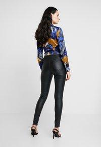 Dorothy Perkins - COATED FRANKIE - Pantalones - black - 2