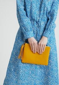 Dorothy Perkins - TASSEL - Clutches - yellow - 1
