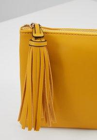 Dorothy Perkins - TASSEL - Clutches - yellow - 6