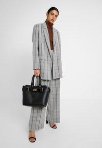 Dorothy Perkins - BELTED TOTE - Handbag - black - 1