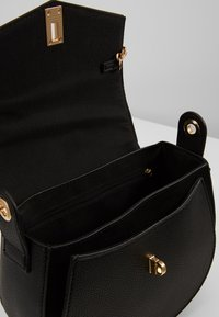 Dorothy Perkins - EYELET SADDLE CROSS BODY - Across body bag - black - 4