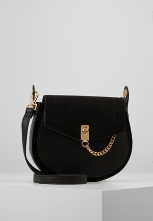 EYELET SADDLE CROSS BODY - Skulderveske - black