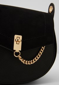 Dorothy Perkins - EYELET SADDLE CROSS BODY - Across body bag - black - 6
