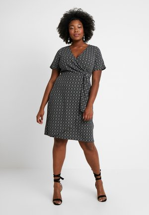GEO PRINT SHORT SLEEVE RING WRAP - Jerseykjole - black