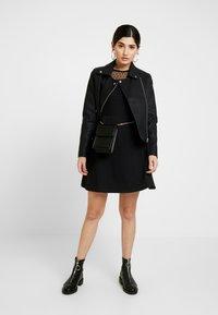 Dorothy Perkins Petite - DOBBY FIT AND FLARE DRESS - Vestito di maglina - black - 1