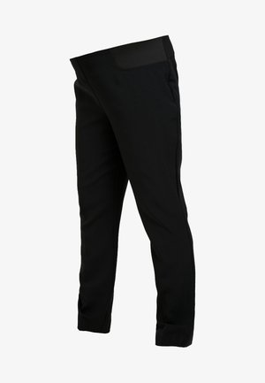 UNDERBUMP TROUSERS - Trousers - black