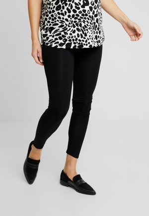 OVERBUMP - Leggings - black